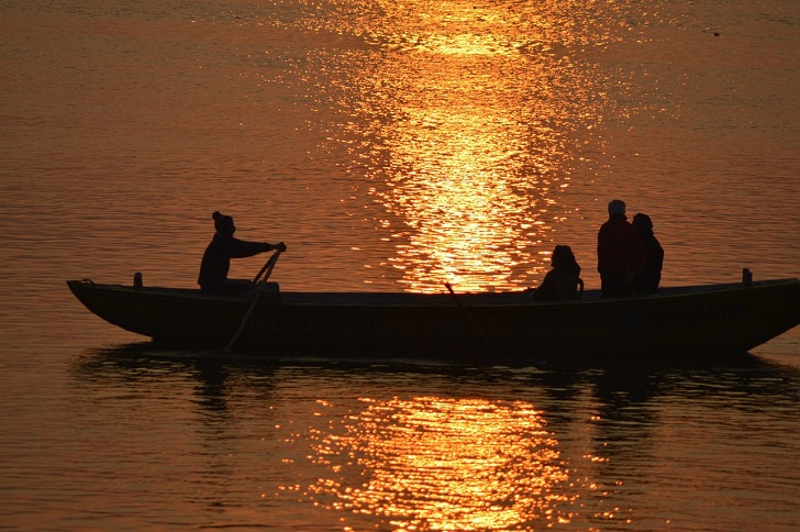 Sunrise in a boat on the Ganges
